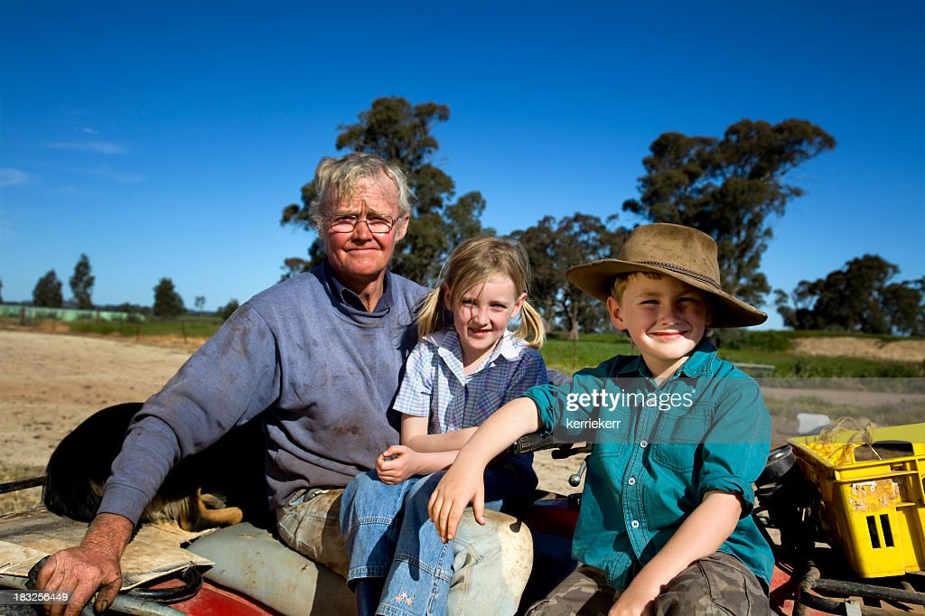 Man with his son and daughter in the country