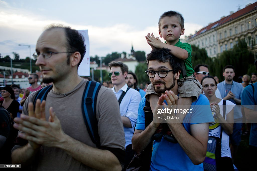 A man with his son attend the protest against the caretaker government of Czech Prime Minister Jiri Rusnok on August 6, 2013 in Prague, Czech Republic. Rusnok's caretaker cabinet, which Czech President Milos Zeman appointed July 10 despite protests from most political parties in the Czech Chamber of Deputies, will go through a vote of confidence in parliament tomorrow, August 7. Leaders of the former center-right coalition parties said they will not support Rusnok's government in tomorrow's vote.