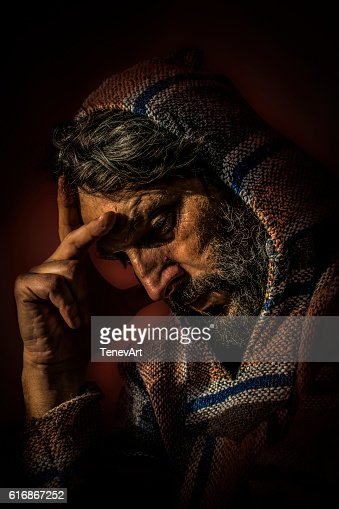 Man with Hood in Deep Thought and Wistfully view : Stock Photo