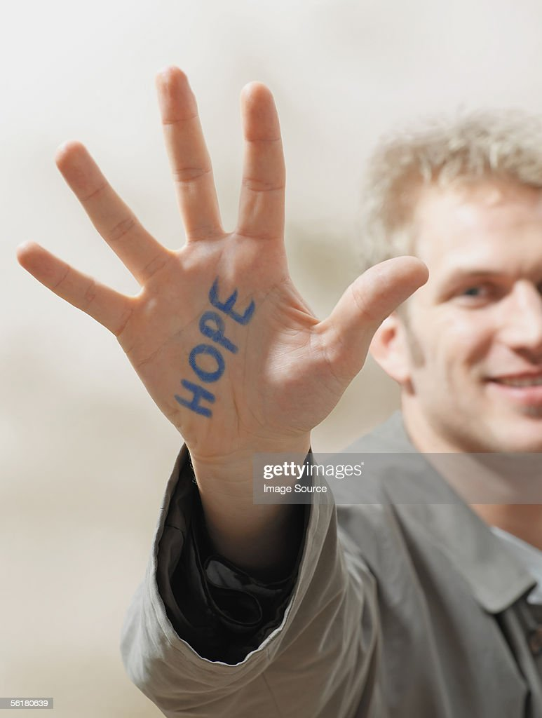 Man with hope written on his hand : Stock Photo