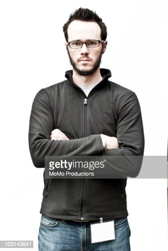 Man with ID tag on white background. : Stock Photo