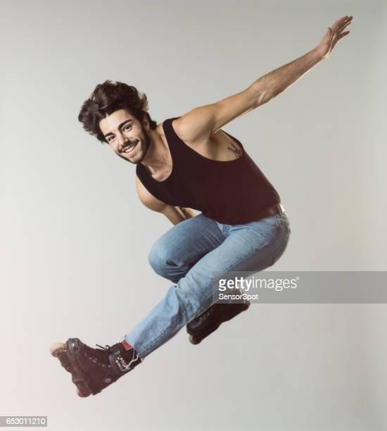 Man with inline skates perform tricks