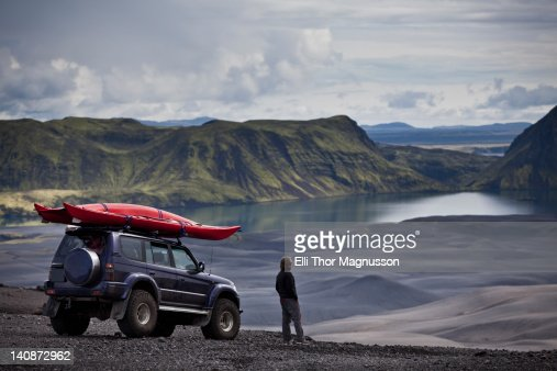 Man with Jeep admiring rural landscape