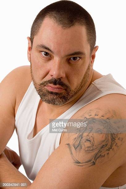 Man with Jesus tattoo on arm, portrait