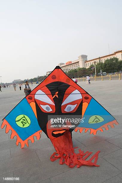 Man with kite in Tiananmen Sqaure.