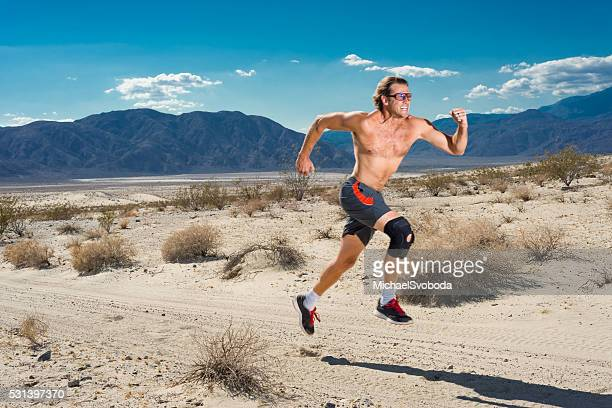 Man With Knee Brace Running In The Desert