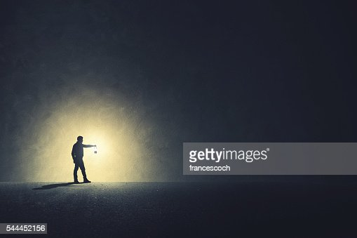 Man with lamp walking illuminating his path : Stock Photo