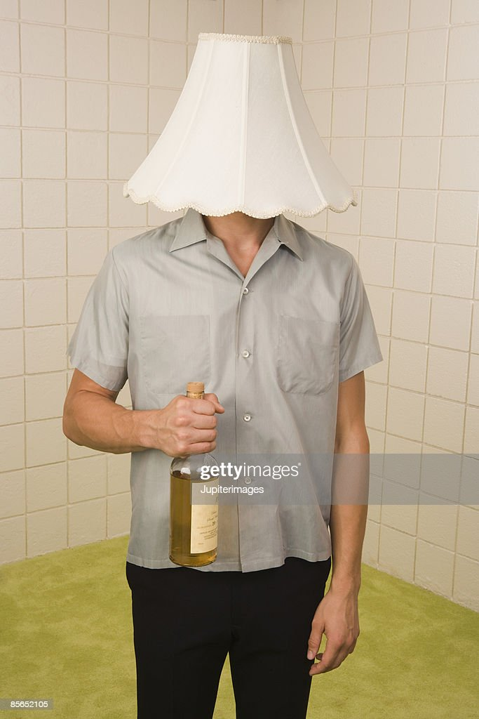Man with lampshade on head : Stock Photo