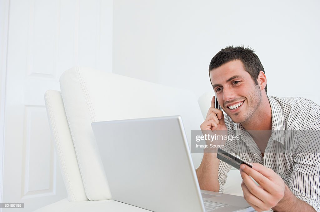Man with laptop cellphone and credit card : Foto stock