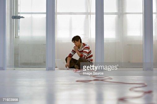 Man with laptop on floor : Stock Photo