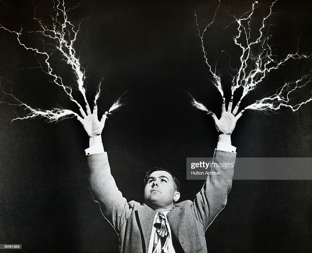 Man with lightning shooting from fingers (B&W) : Stock Photo