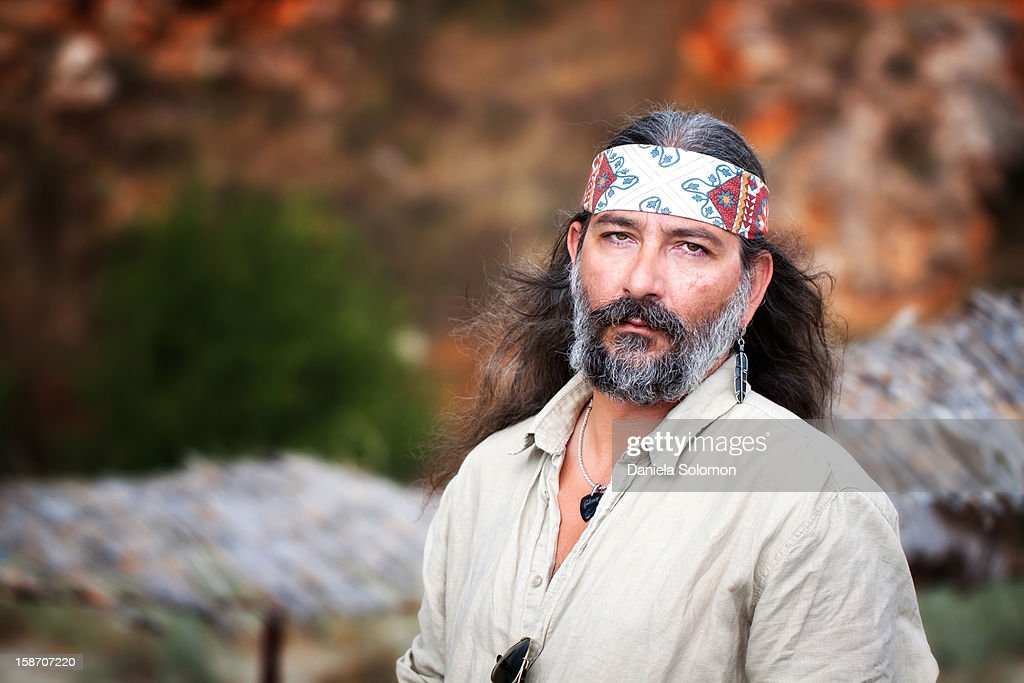 Man with long hair and headscarf : Stock Photo