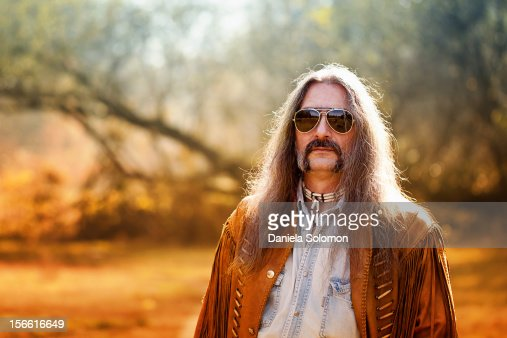 Man with long hair and sunglasses : Stock Photo