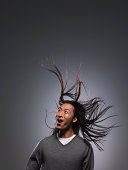 Man with long hair blowing in wind