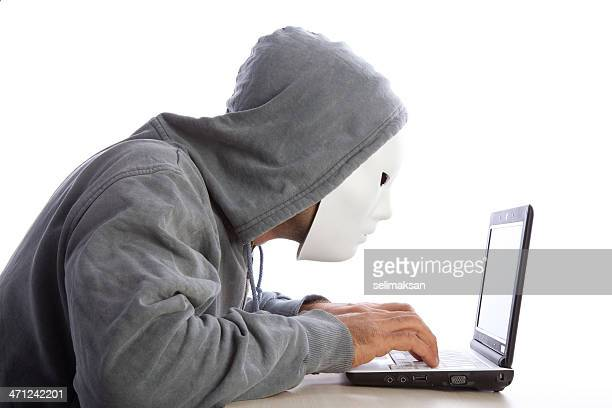 Man With Mask And Hood Using Computer, Internet Security Concept