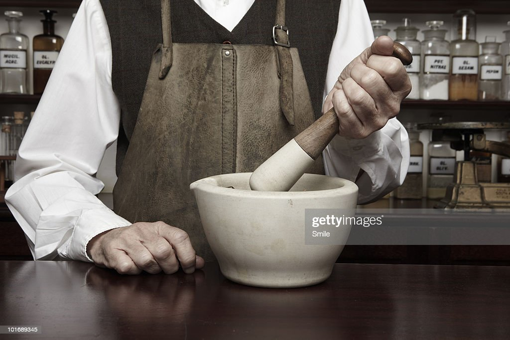 Man with mortar and pestle