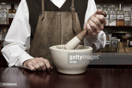 Man with mortar and pestle : Stock Photo