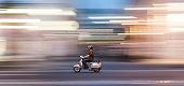 man with motorbike in speed in Vienna, Austria.