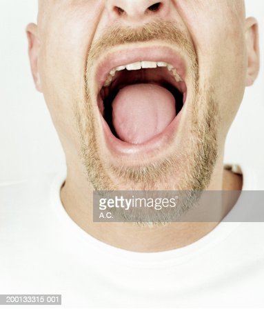 Man with mouth wide open, close-up of mouth : Stock Photo