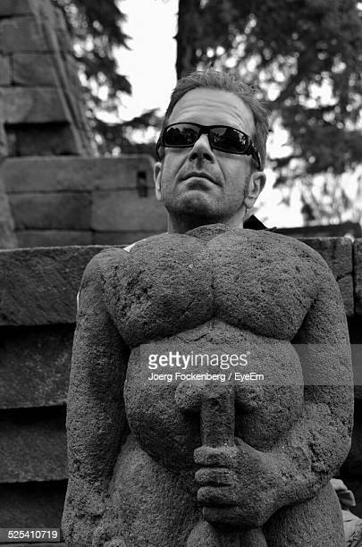 Man With Naked Statue