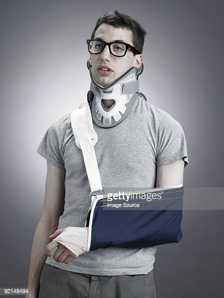 Man with neck brace and arm in sling