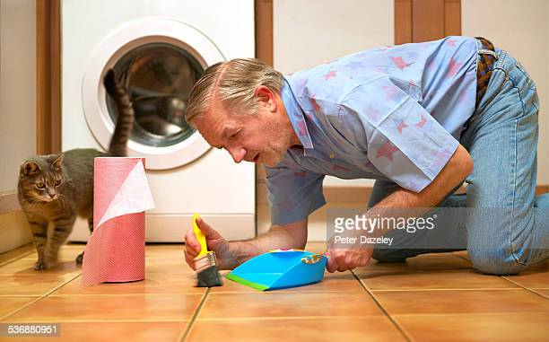 Man with OCD cleaning kitchen floor