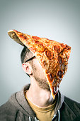 Man with Oversized Pizza Slice on Head