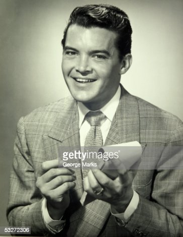 Man with pad and pencil : Stock Photo