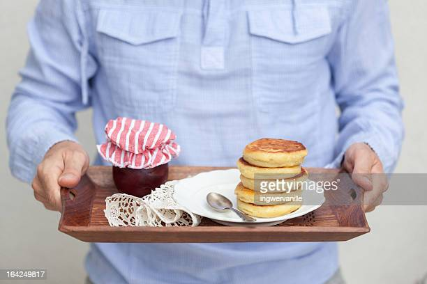 Man with pancakes with jam