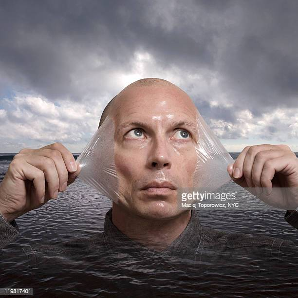 Man with peeling skin emerges from water