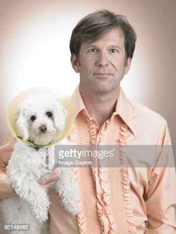 Man with pet poodle