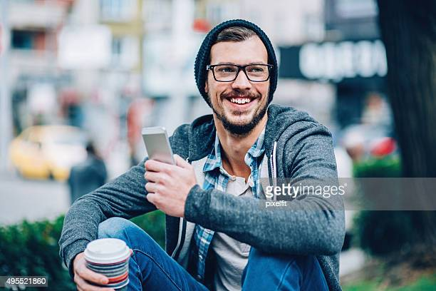 Man with phone outdoors