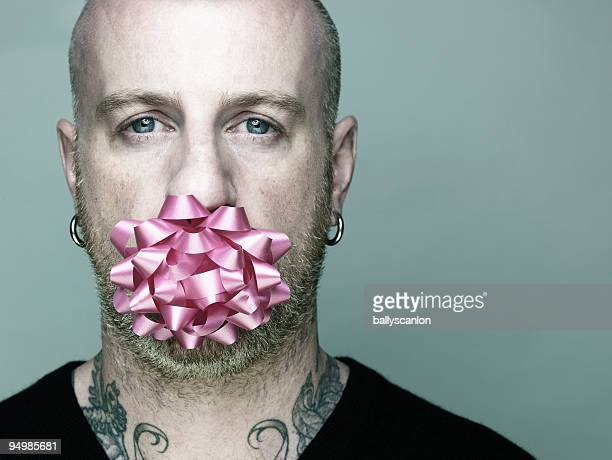 Man with Pink Ribbon in Mouth.