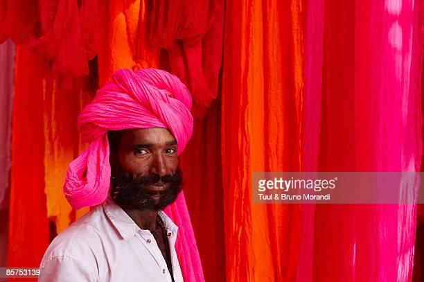 man with pink turban in Sari Factory.