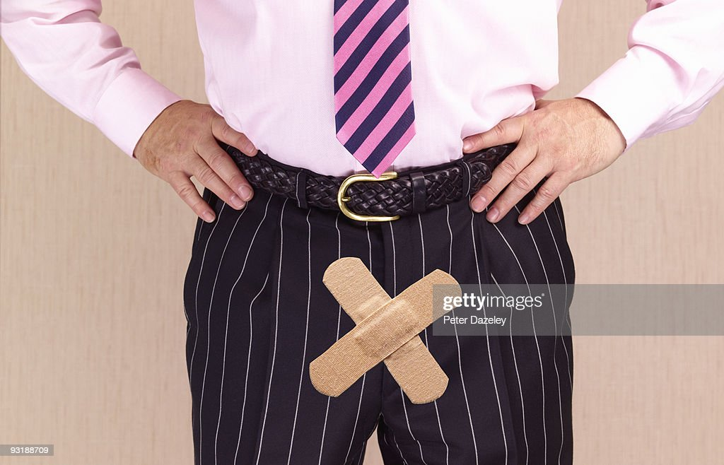 Man with plasters over crotch. : Stock Photo
