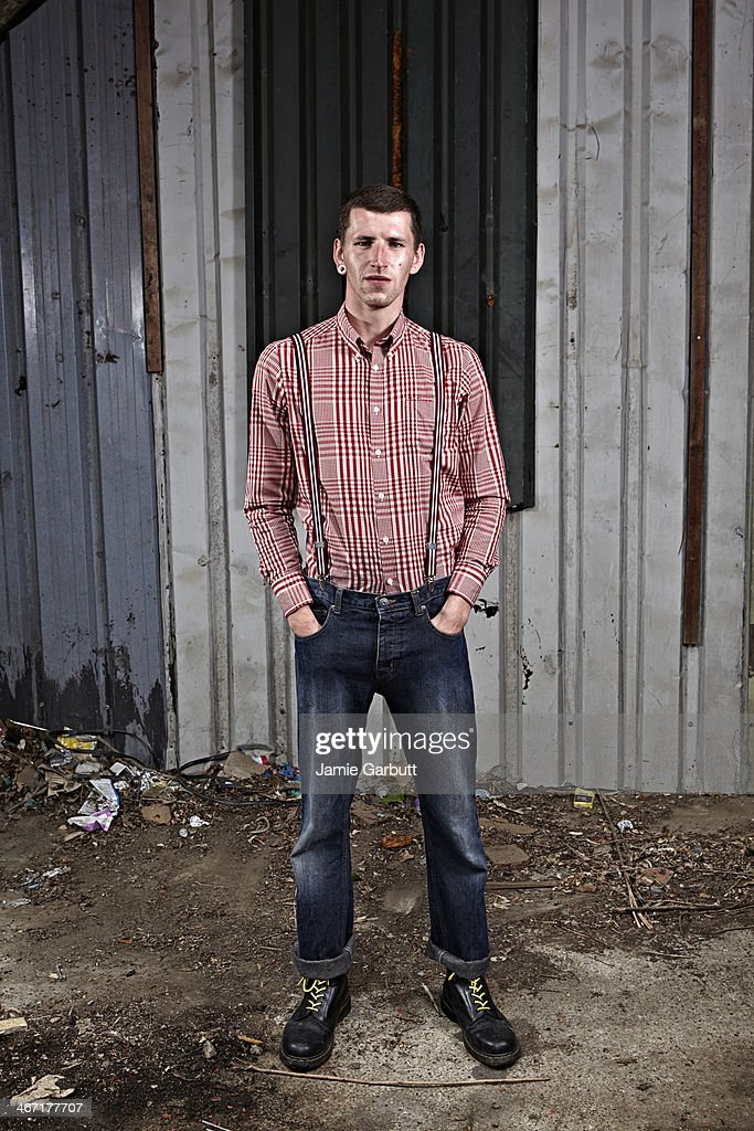 Man with plug ear piercing and red and white shirt : Stock Photo