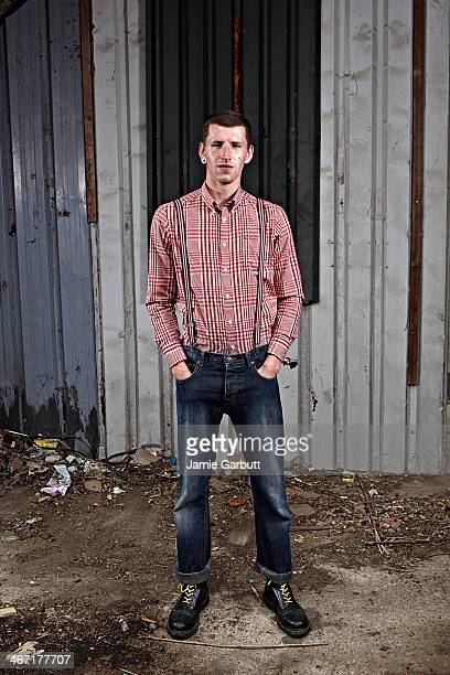 Man with plug ear piercing and red and white shirt