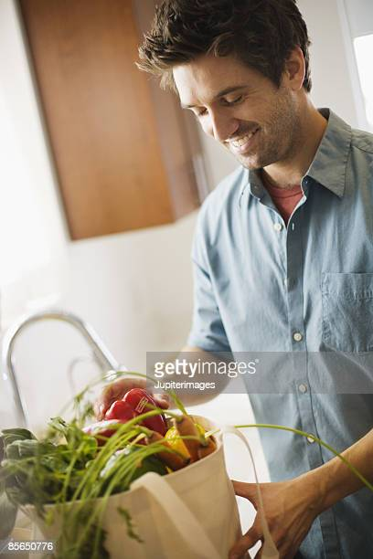 Man with produce in canvas bag