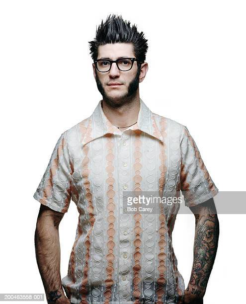 Man with pronounced sideburns wearing vintage striped shirt