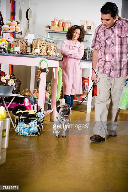 Man with Pug in Pet Shop