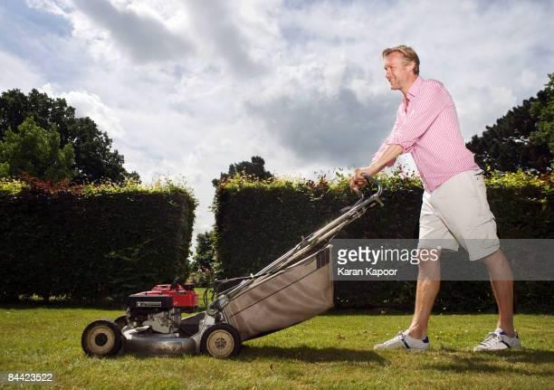 Man with push lawnmower