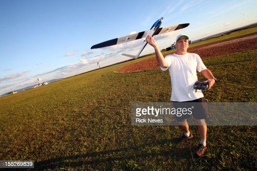 Man with radio control airplane