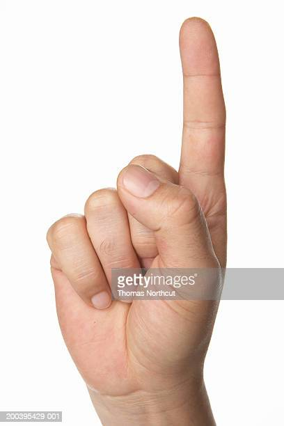 Man with raised finger (focus on hand)