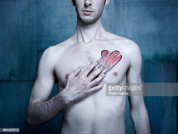 Man with red heart smeared across his chest