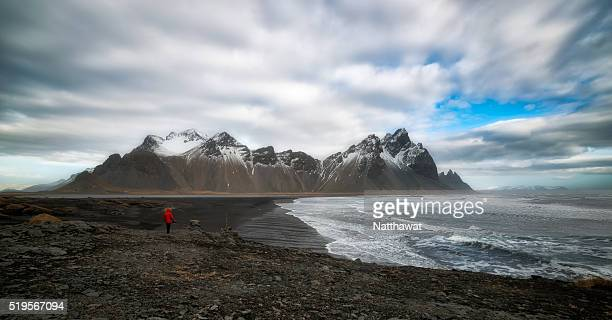 A Man with Red Jacket at Vesturhorn, near Hofn, Iceland