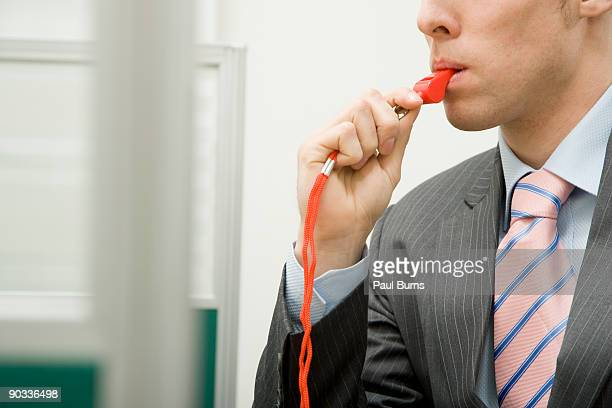 Man with Red Whistle in Office