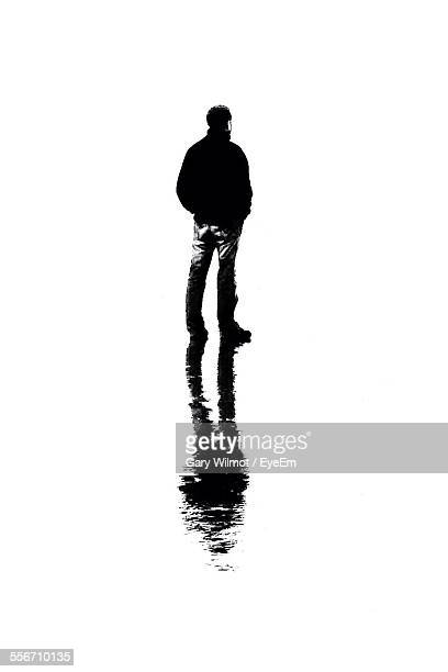 Man With Reflection Standing Over White Background