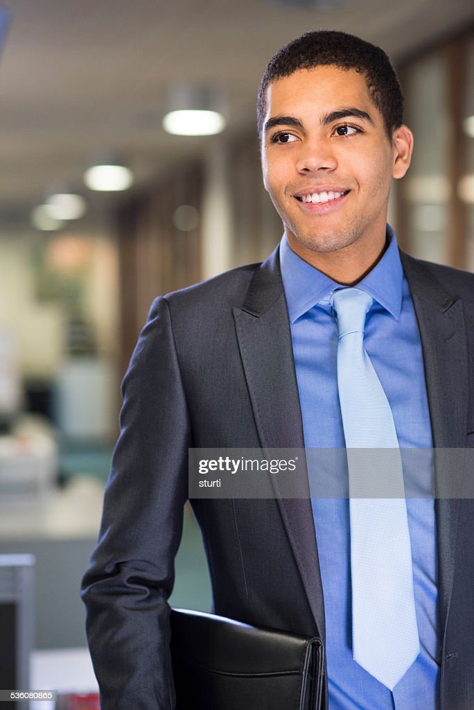 man with resume under his arm arrives for  interview