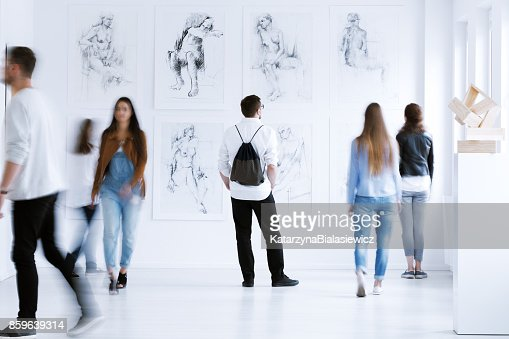 Man with rucksack in gallery : Stock Photo