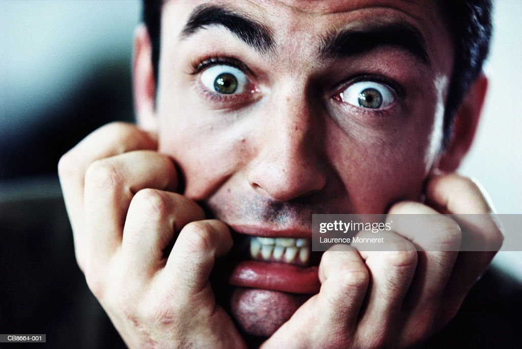 Man with scared expression, close-up : Stock Photo